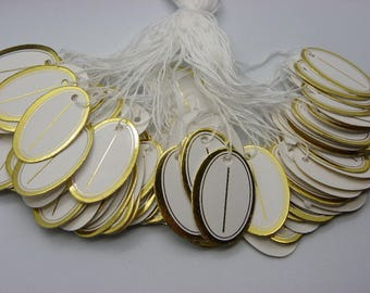 100 oval labels with a border of gold 26 mm x 17 mm