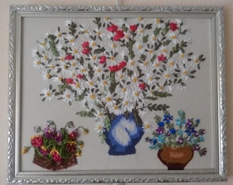 Embroidered flowers in vases