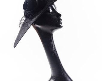 Black fascinator with silk  flower detail