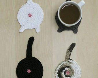Four Cup holders, woven in the shape of cats