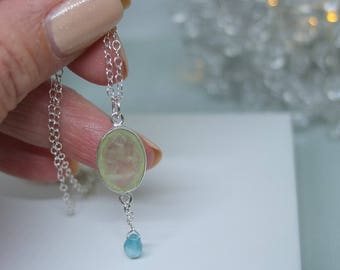 Sterling silver necklace with prehnite and apatite pendant.