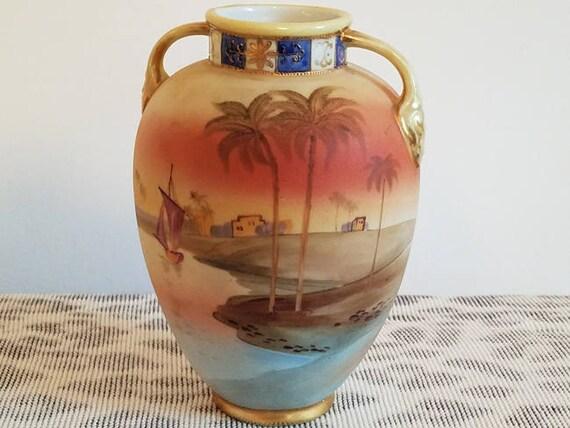 Antique Nippon Japan hand painted porcelain ceramic vase urn with eared handles Egyptian dessert oasis scene