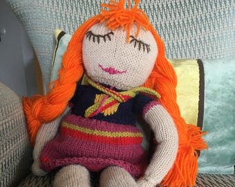Hand-knitted doll with long braids