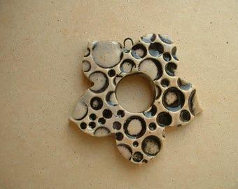 Fleur de lys textured glazed ceramic pendant
