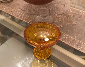 Vintage pressed gold glass candy dish on a pedastal