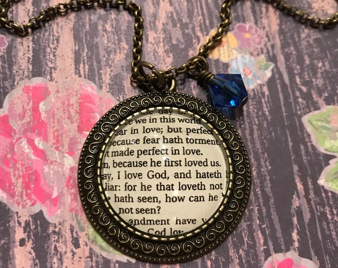 Because he first loved us Bible page necklace