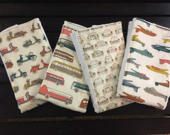 Transportation baby burp cloths with cars, planes, buses, and scooters on Cotton Babies cloth diapers