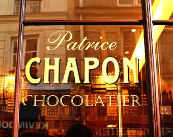 Fine art photograph of the window pane of Patrice Chapon's Parisian chocolatier shop in Paris, France. Free Shipping in the U.S.