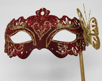 Red and Gold Butterfly Mask on a Gold Stick
