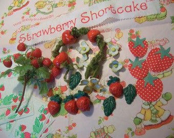 bunch of strawberry craft items