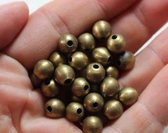 Heavy vintage solid brass beads