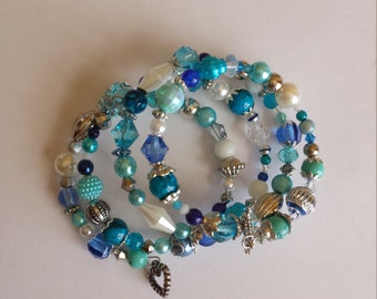 Bracelet 4 row memory wire - glass beads and acrylic blue tones