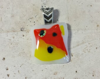 Fused glass pendant necklace; white glass with yellow and orange glass and black dichroic; candy corn pendant