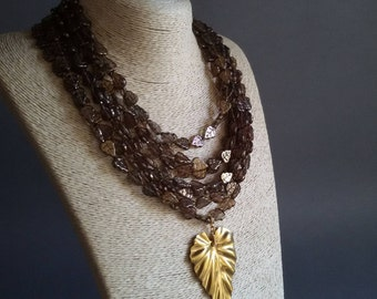 Brown Gold statement necklace. Big bold chunky necklace. Multi strand beaded necklace with gold brass leaf pendant. Czech glass jewelry.