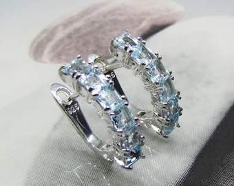 Earrings-pierced silver rhodium and Blue Topaz