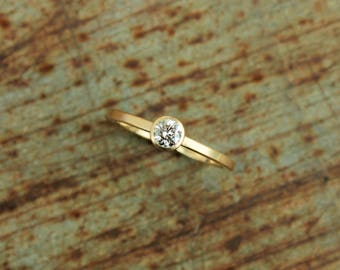 750 gold ring with diamond