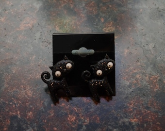 black cat earing