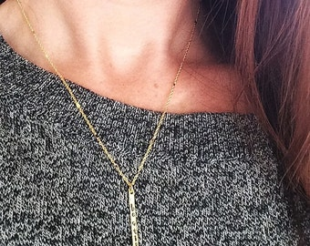 b e  s t i l l - hand stamped gold stick pendant necklace