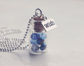 glass vial with blue crystals necklace