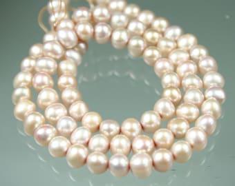 "16"" Strand Lustrous Potato Pearls 6-7mm."