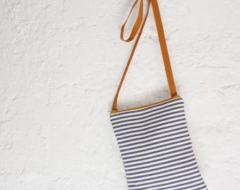 A handmade  small crossbody bag in blue and beige striped cotton, perfect for a womens gift or to birthday gift