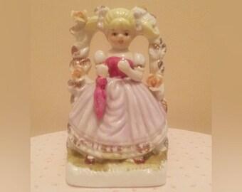 Vintage Girl Beneath Floral Trellis Figurine