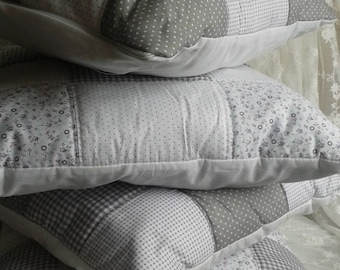 White-grey cushion patchwork squares and flowers