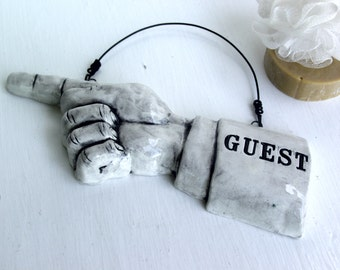 Guest.  Fired Ceramic Pointing Finger.  Tell Them Where To Go.   Recycled Clay.