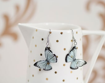 Light blue butterfly earrings. A lovely piece of transparent and unique vegan jewellery. Comes in our branded jewellery boxes.