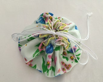 """Floral Jewelry Bag with 8 Sheer Pockets Blue Floral Print, White Sateen inside, White Iridescent Drawstrings 6"""" across when closed Hand Made"""