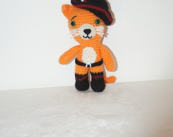 """Puss in boots the outlaw kitty says """"Stay furry, my friends"""". Crocheted soft toy by Liz"""