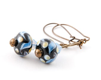 Lampwork glass, Swarovski crystal and brass wire-wrapped earrings in black and blue