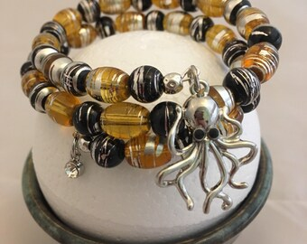 Amber, black and silver beaded wire bracelet