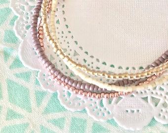 Dainty four strand friendship bracelet. Purple pink seed bead friendship bracelet.