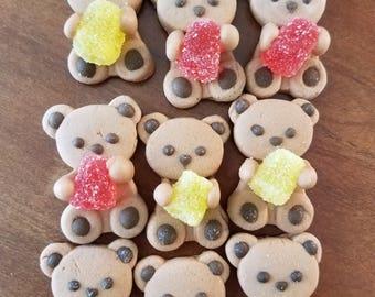 Mini teddy bears holding gum drop. Cupcake or cake decoration