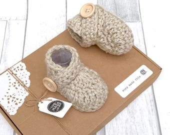 Baby booties in box