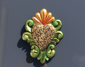 wooden heart with milagros