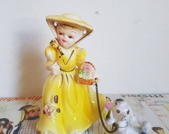 Vintage Kitsch Lady with poodle on chain yellow dress flower basket ceramic figurine nursery decor  baby shower pastel cake topper