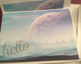 Set of six galaxy themed notecards. All different. Enveloped lined to match card.