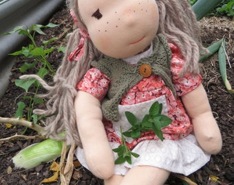 Hand made doll. Daisy is ready to play. All natural fibre doll