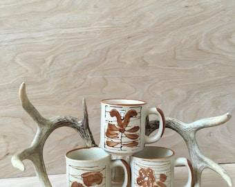 Ceramic mug set, hand painted, 1960s, 60s, floral, brown, irvory, vintage ceramics, vintage mugs, coffee cups, tea cups, set of three