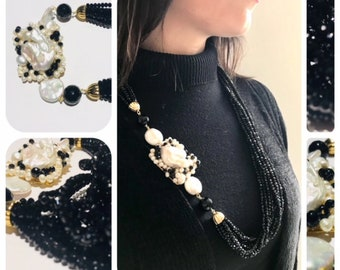 Multithreaded necklace with rock crystals, river pearls, Scaramazie pearls and onyx