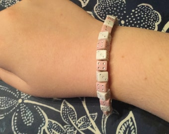 Pink and white dice bead bracelet