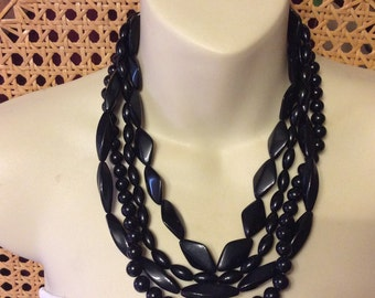 Vintage signed Icing 1950's black beaded multi srand necklace.