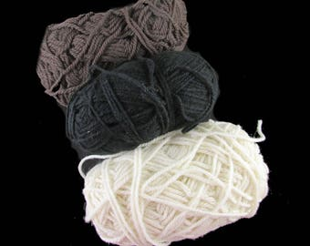Lot of 3 partial skeins of yarn- as shown in photo