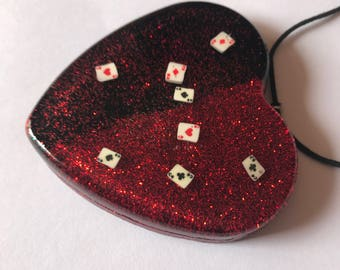 Creation of red heart resin with playing cards