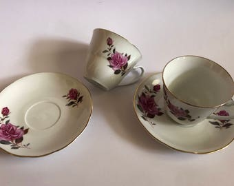 Pair of rose tea cups with saucers.