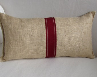 blonde burlap lumbar pillow with decorative tape in poppy