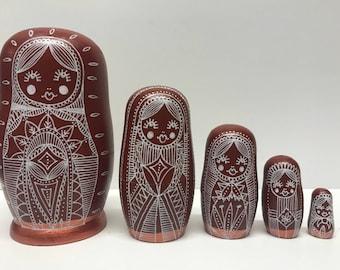 Russian nesting dolls, matryoshka babushka dolls, wooden dolls in dolls