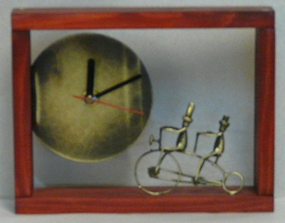 Desk bronze clock with wooden frame.